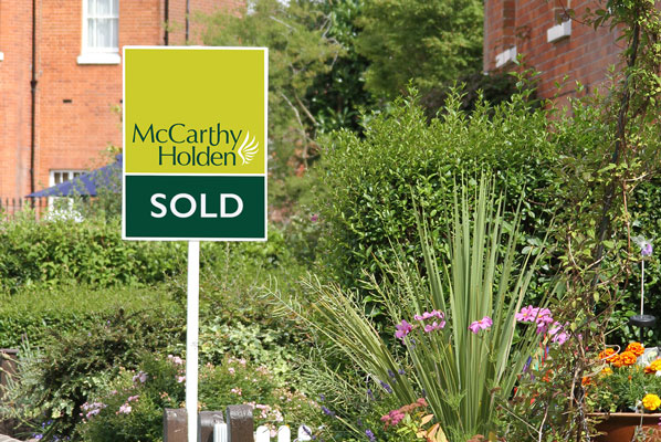 McCarthy Holden estate agents sold board